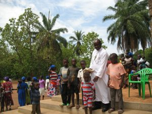 brother-achilleo-kiwanuka-after-mass-with-the-little-ones-at-rimenze-parish